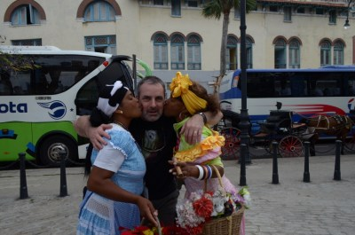 Two official tourism people kissing hubby.
