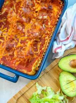 Imposing Avocado Andlettuce Healthy Vegetarian Mexican Lasagna An Easy Dinner Recipe Tex Mex Recipes Enchiladas Tex Mex Recipes Beef A Blue Dish Next To Cutting Board Baked Mexican Lasagna