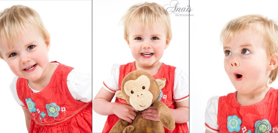 Portrait of a toddler little girl dressed in red holding her monkey toy professional studio photography by Anais Chaine in Auckland Ponsonby New Zealand