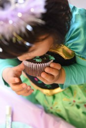 child eating a cup cake taken from above