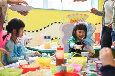 happy children sitted around the birthday table happy