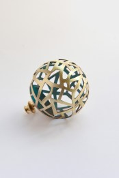 Wandering energy, brass and grey-green patina brooch.