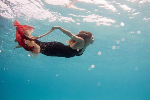 Woman photographed underwater with dress