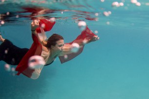 woman swimming underwater in Fiji