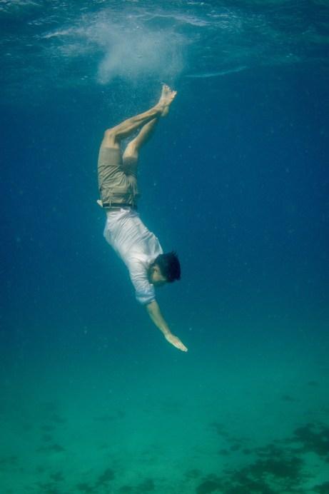 Groom diving underwater