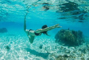 woman with toes tipped underwater photography and coral in Fiji by Anais Photography