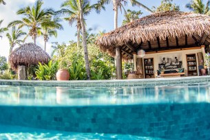 over under shot with the pool in the bottom and Tokoriki island resort on the top in Fiji by Anais Photography