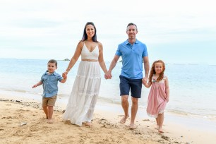 cute family stroll on the beach in Malolo Island Resort Fiji