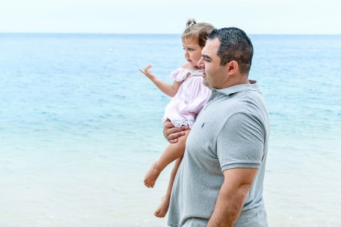Father and daughter on the beach at Malolo Island Resort Fiji