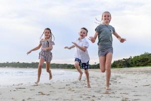 Children running on the beach in Natadola Fiji