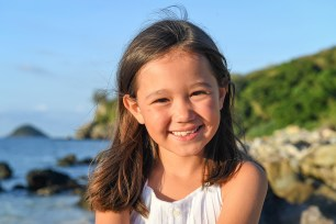 Stunning brunette little girl on the beach in Malolo Fiji Castaway Island