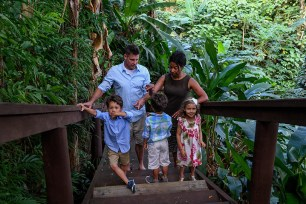 Triplets with their family in tropical rain forest during Fiji family vacation