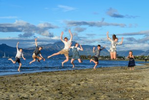 Kids to a frog leap in the air over the beach at Denarau Fiji