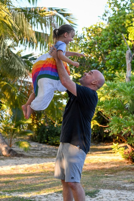 Father tosses daughter in the air