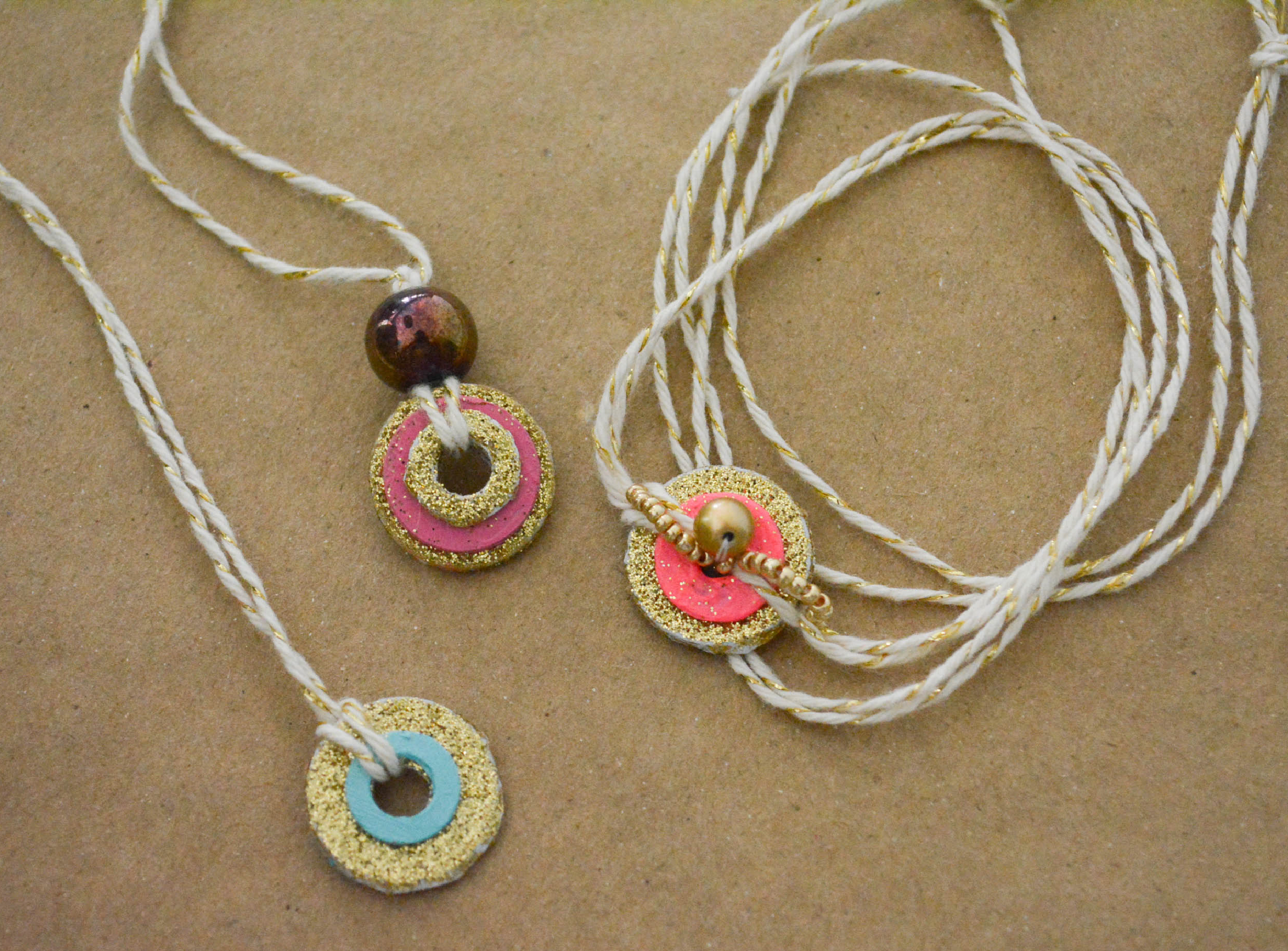 with scrapbook washer paper pin necklace made