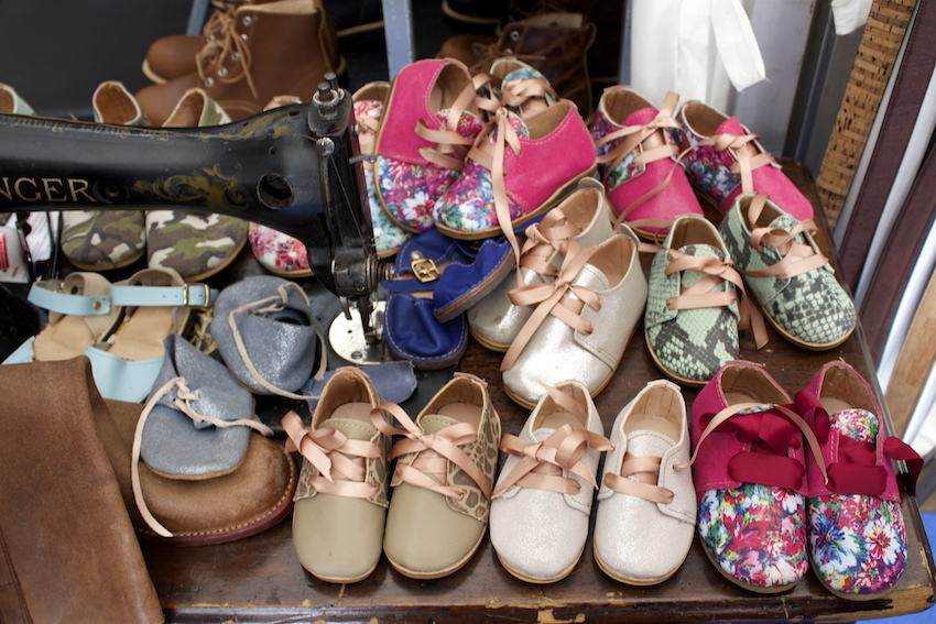 Handmade children's shoes at a market in Lisbon