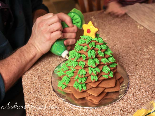 Andrea Meyers - piping icing on the gingerbread Christmas tree