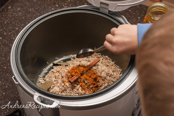 Andrea Meyers - Adding spices to brown basmati rice.