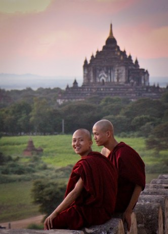 young Buddhist monks enjoying sunset in Bagan, Myanmar