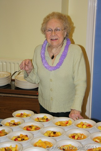 COUNTING THE BOWLS_Marion Brookes ensures there is enough fruit salad to go around.