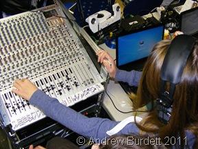MIC CHECK_A 'techie' operates the sound desk.