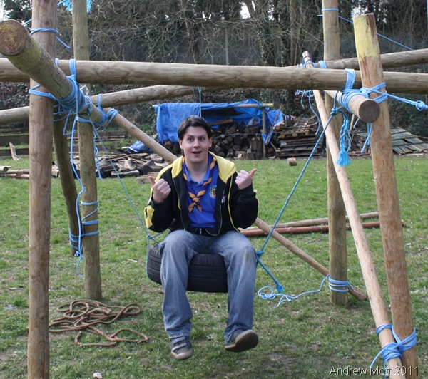 THUMBS UP_Leader Damien Woodall poses on the swing-type throne.