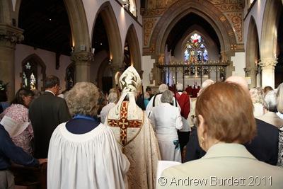 LINE THE AISLE_The procession walks down the aisle.