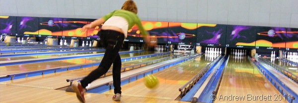 AT IT, GIRL!_A camper throws a ball at Bristol Bowlplex.