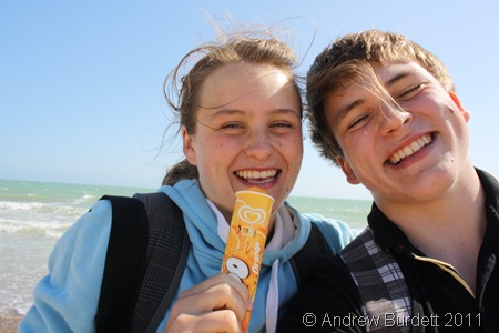 COOL KIDS_Harriet and me on the beach; H with a lolly, A with a chocolate messy upper-lip.