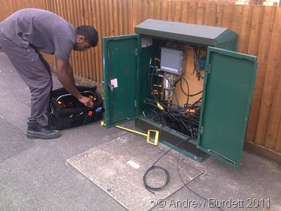 STREET CAB_An engineer patches up a new customer.