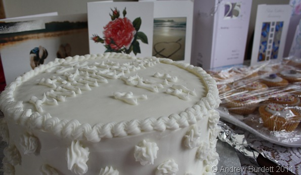 ICING ON THE CAKE_Mum and Dad's silver wedding anniversary cake, in front of cards from family and friends.