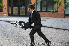 QUICK_Matthew returns brollies to guests who'd forgotten them. (1 of 4)