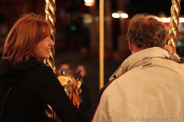 SENIOR MOMENT: An older couple take a ride on the Carters Gallopers, hand in hand. (IMG_2825)