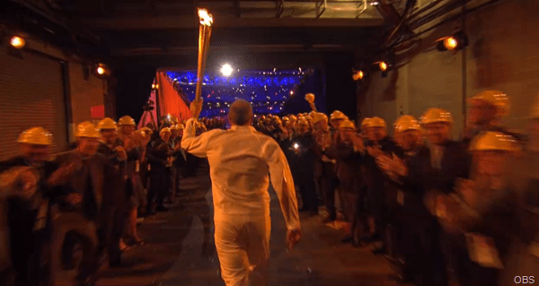 THE REAL LEGENDS: 500 of the people who built the Park saw the Torch enter the Stadium.