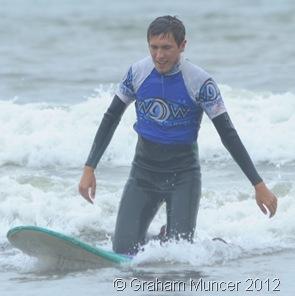 KNEELER: Assistant Leader Alex rode a wave. (0563_20120808_DSC3362_GrahamMuncer)