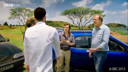 LAB-COAT MAN: An assistant provides details of the real challenge that lies before the presenters- and their cars.