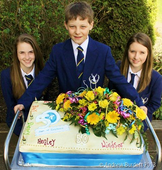 PREPARATION TIME 50 YEARS: Sophie Hurst, Christopher Pearce (the school's youngest student), and Alexandria Piggott with the school's celebratory cake. (IMG_8673-edit_ARB)