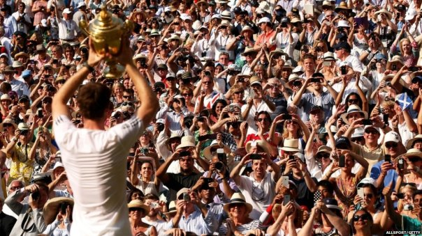 THE WINNING CROWD: Andy Murray displays the trophy to the cheering supporters.