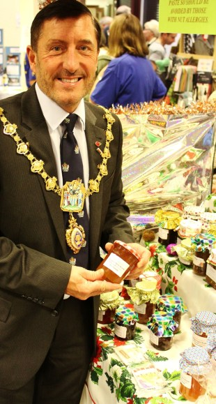 RBWM Mayor Andrew Jenner with produce at St Luke's stall.