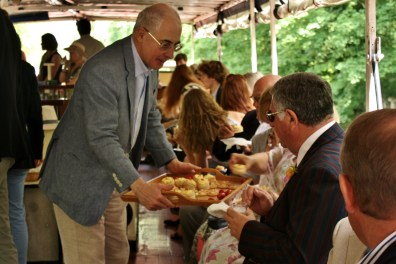 Rhidian Jones serves canapés to guests, once on board.