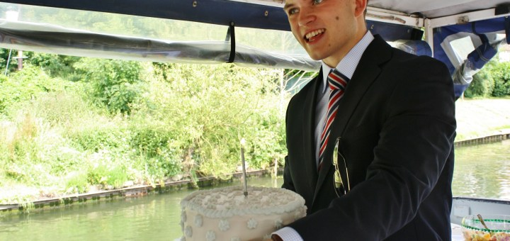 With its candle lit, Andrew Burdett was delighted with the cake father Richard had made.
