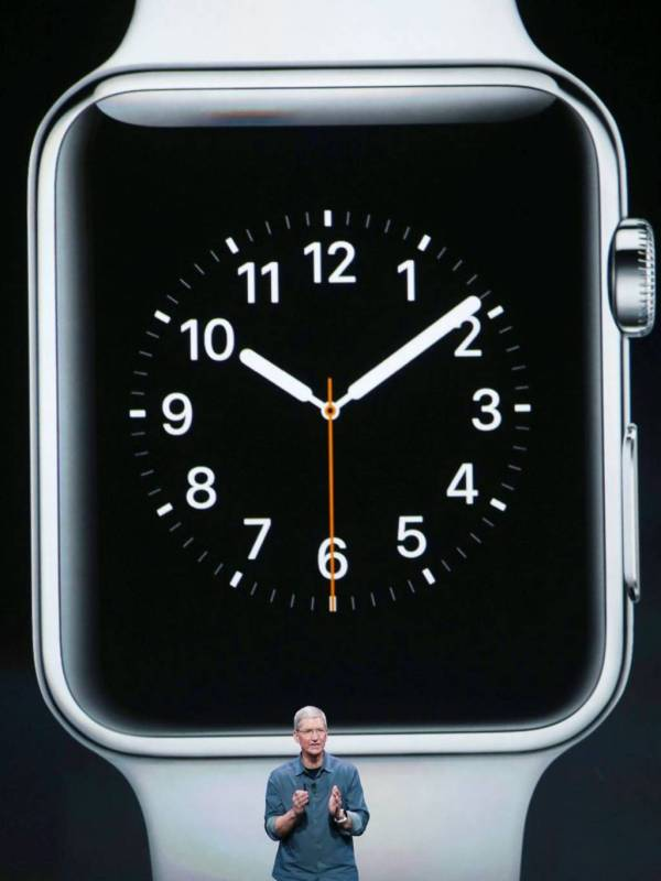 Tim Cook revealing the Apple Watch at a press conference in California.