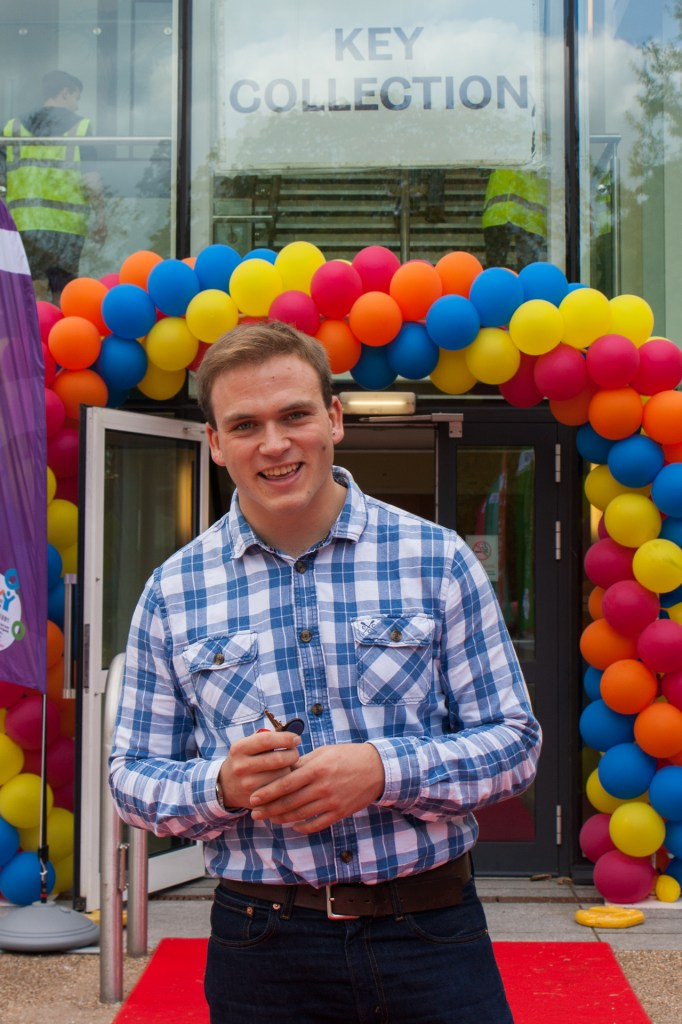 Andrew Burdett on accommodation move-in day, with key to his university apartment.
