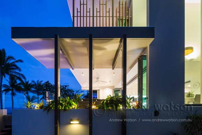 Twilight exterior image of architectural beachfront home in Cairns