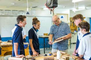 Image of teacher instructing students in manual arts class