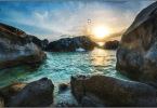 trey-ratcliff-july 28-boulders-on-the-beach-stuck-in-customs