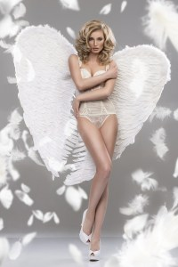 Photo Of Sexy Blonde Woman With Long Hair Wearing Angel's Wings.