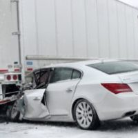Within a week's time, 1 driver survived a crash with a trailer, 1 driver did not.