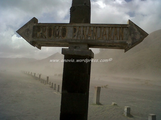 This sign is at the centre of the desert, before you reach the Hindu temple by the foot of the crater
