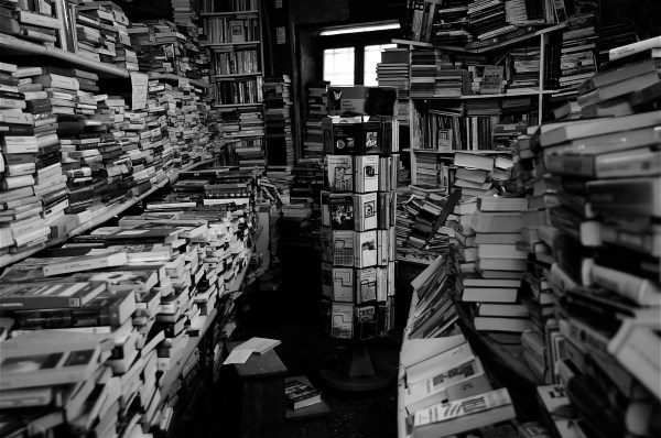 a cluttered bookstore, venice, italy